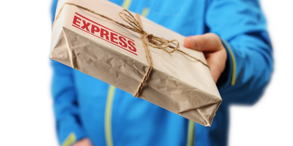Male courier service worker holding express delivery package